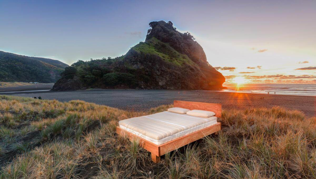 Natural Sunflower Mattress (King Size) and Riva Frame (Macrocarpa Timber) on Piha Beach